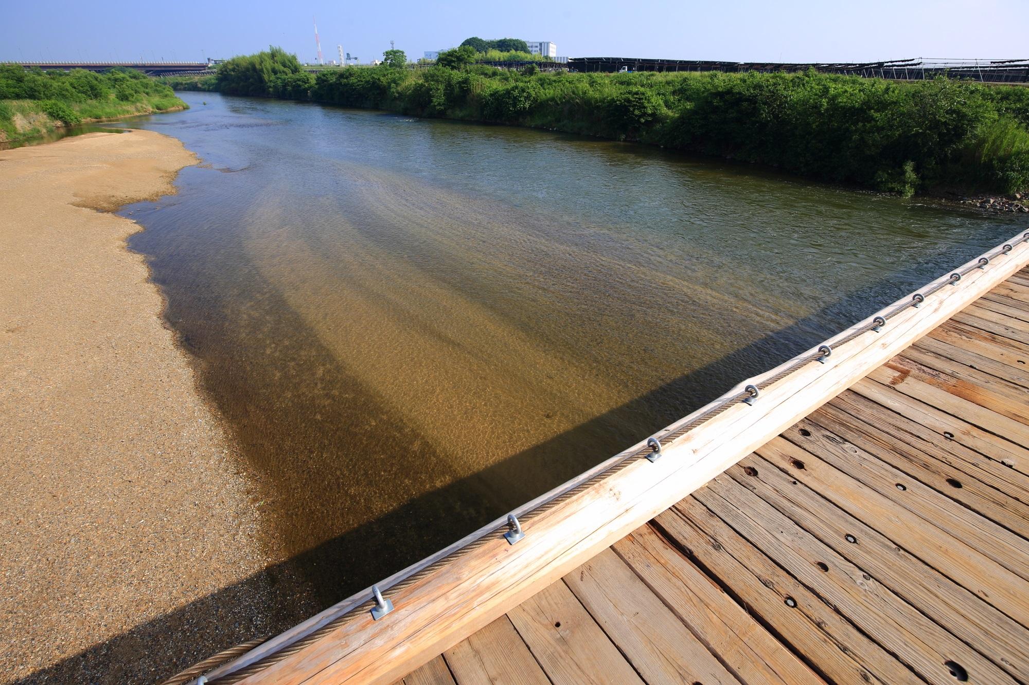木津川にかかる増水で流される上津屋橋