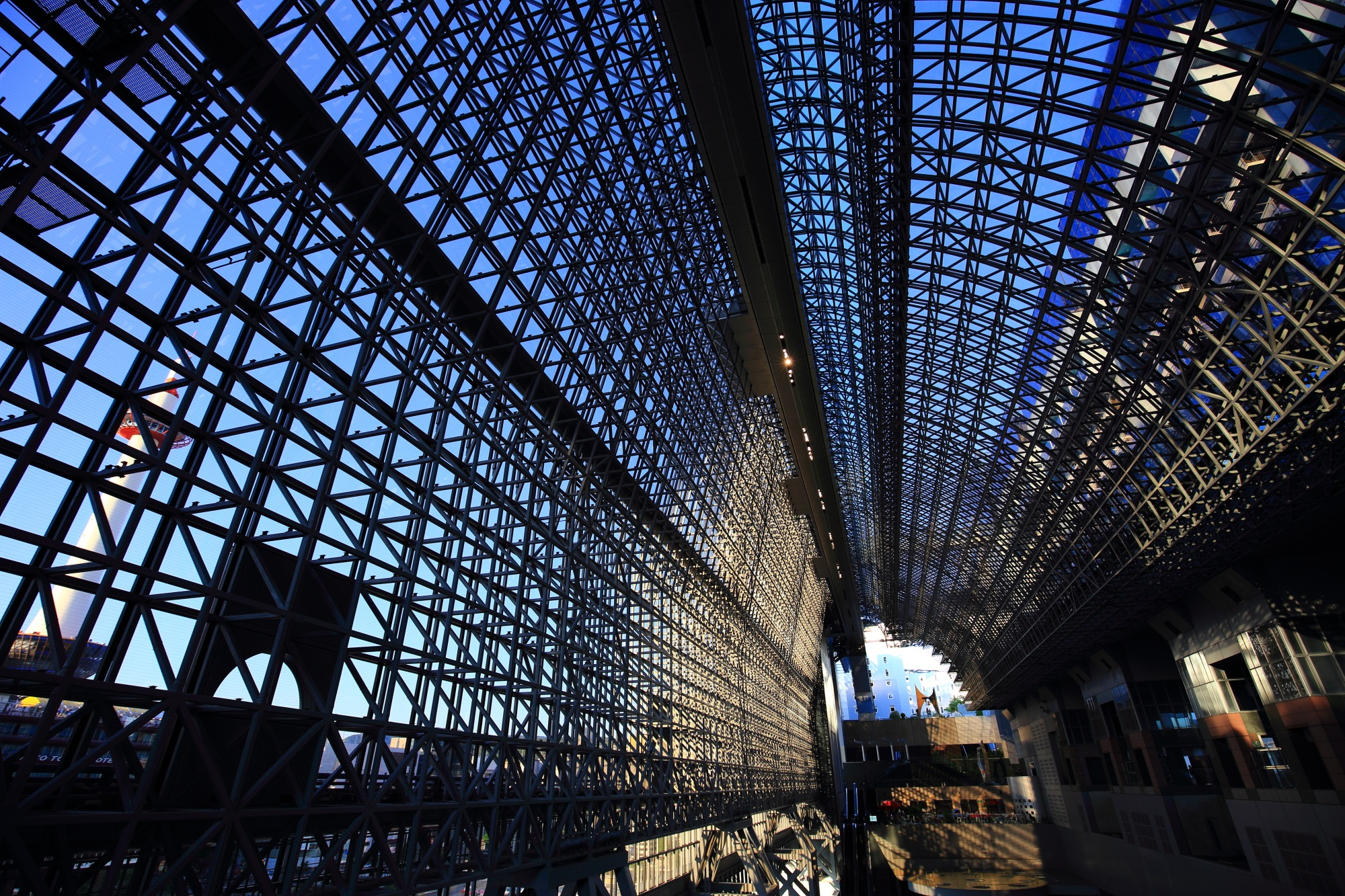 Clean glass and blue sky of Kyoto Station Building in Japan