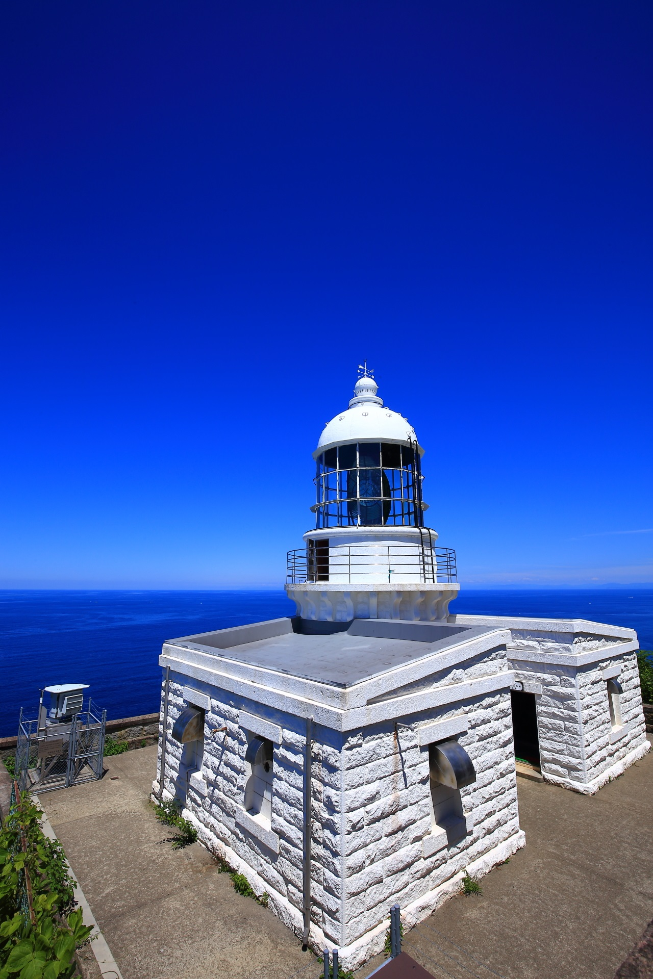 Kyoga-Misaki Lighthouse in Kyotango and blue sea and blue sky