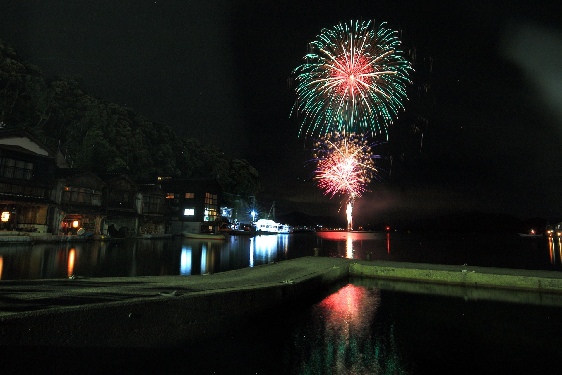 Ine-no-Funaya and colorful fireworks in Kyoto,Japan